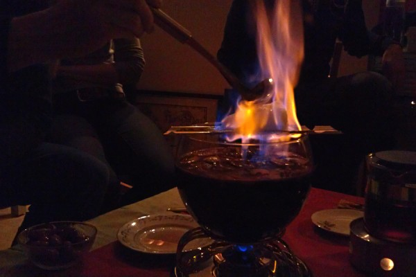 Preparing a Feuerzangenbowle - burning the sugar not the couch table
